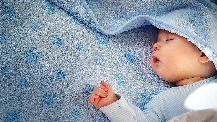 Em bé đi ngủ